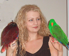 This is me, Michele, with my 2 eclectus parrots, Ollie and Pepper